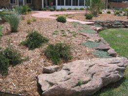 Moss rock boulder to end wall near Lafayette Colorado
