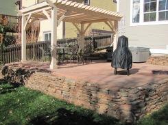 Cut Flagstone Patio w/Moss Rock Wall and Pergola