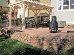 Cut Flagstone Patio w/Moss Rock Wall and Pergola