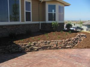 Broomfield Colorado Moss Rock Wall with Perennials