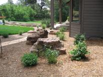 Cut Buff flagstone wall divides walk and lawn