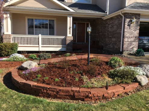 Flagstone walkways and wall with perennials and shrubs near Lafayette Colorado