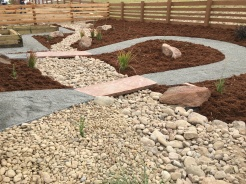 Zen riverbed with perennials and veggie garden boxes near Broomfield, Colorado