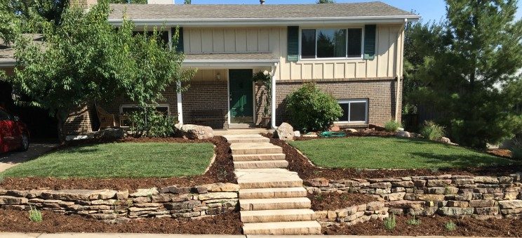 Buff slab stairs with moss rock dry stack retaining walls planted with thyme inear Louisville, Colorado