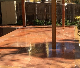 Red Flagstone cut stone patio under a deck in Louisville, CO