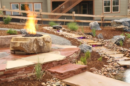 A waterfall and fire pit
