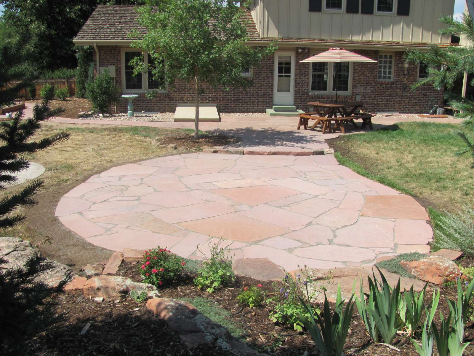 Lyons Red Flagstone Patio Addition With Polymeric Sand