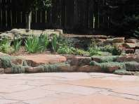 Louisville, Colorado area Patio with Moss Rock Wall and Thyme