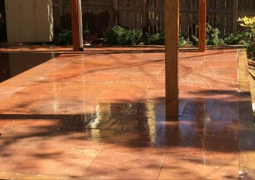 Hardscapes....Red Flagstone cut stone patio under a deck in Louisville, CO