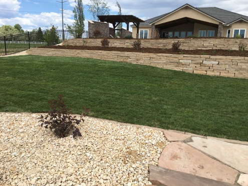 Buff cut stone retaining wall near Louisville, CO
