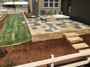 Louisville, Colorado area Buff and PA Bluestone Patio with supporting Buff wall
