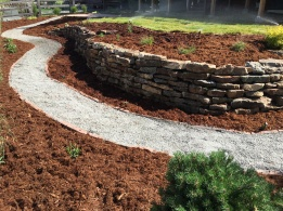 Louisville Colorado moss rock wall with chipstone path