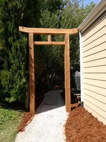 Fun Torii Gate we built as an entrance to this Japanese garden....dry riverbed, trees, shrubs perennials, etc.